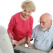 ElderlyCoupleatDesktopComputer